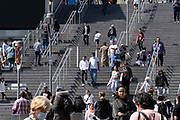 Shoppers descend the steps at one of the entrances of Westfield at Stratford, on 11th August 2021, in London, England.