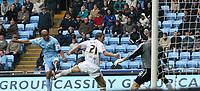 Photo: Mark Stephenson.<br /> Coventry City v Hull City. Coca Cola Championship. 18/08/2007.Coventry's Leon McKenzie (L) fire the ball past Hull's keeper Matt Duke