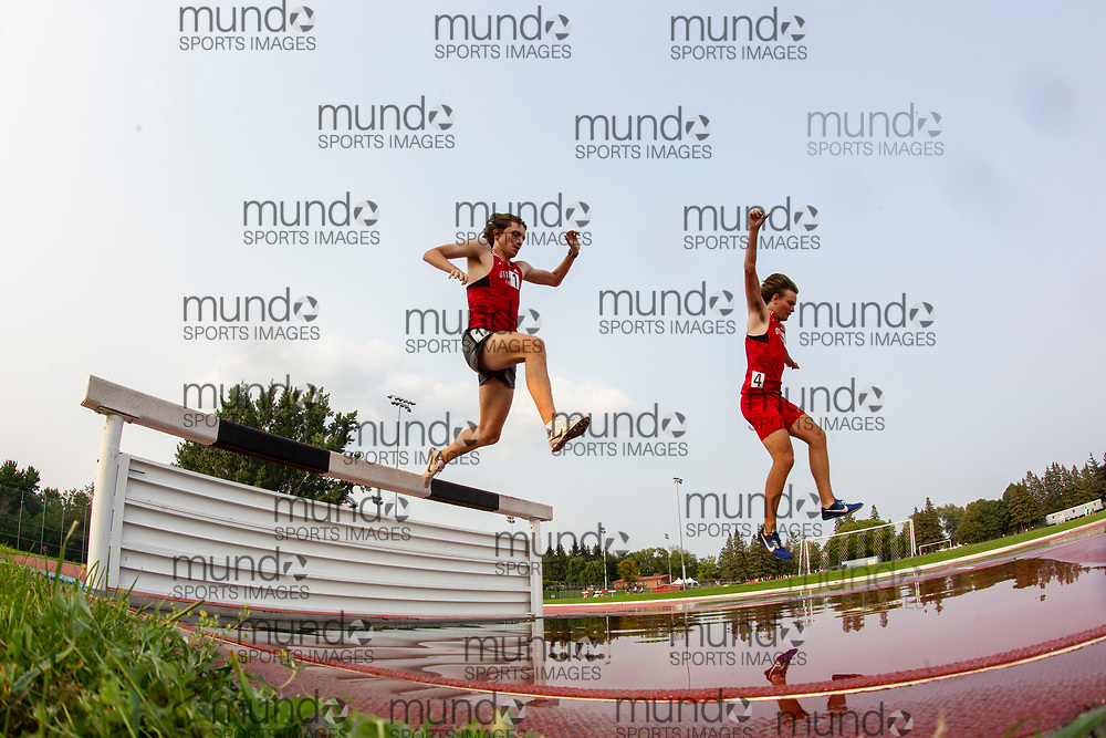 (Ottawa, Canada---04 August 2021) Jackson Roy (1) and Phoenix Bouma (4) competing in the 200m steeplechase at Ottawa Summer Twilight Series 2021 Meet #14, held at the Terry Fox Athletic Facility. Photograph 2021 Copyright Sean Burges / Mundo Sport Images.<br /> <br /> If you post on social media please tag @mundosportimages on Instagram or tag Mundo Sport Images on Facebook.
