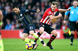 Manchester City's David Silva (left) and Southampton's James Ward-Prowse battle for the ball during the Premier League match at St Mary's Stadium, Southampton.