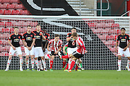 Southampton Matt Target shoots at goal with a free kick during the Barclays U21 Premier League match between U21 Southampton and U21 Manchester United at the St Mary's Stadium, Southampton, England on 25 April 2016. Photo by Phil Duncan.