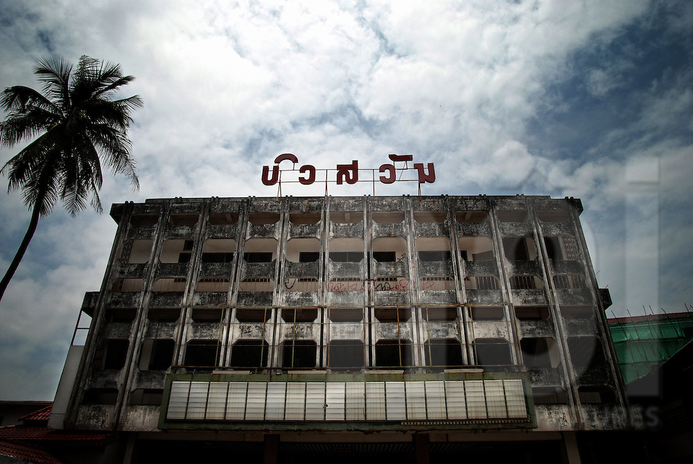 frontage of the cinema Bouasavanh, Vientiane, Laos, Asia. Laos letters rise from the rooftop