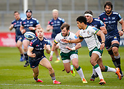 Sale Sharks wing Aaron Reed competes for a high ball with London Irish Fullback James Stokes during a Gallagher Premiership Round 14 Rugby Union match, Sunday, Mar 21, 2021, in Eccles, United Kingdom. (Steve Flynn/Image of Sport)