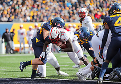 Nov 9, 2019; Morgantown, WV, USA; Texas Tech Red Raiders running back SaRodorick Thompson (28) runs for a touchdown during the second quarter against the West Virginia Mountaineers at Mountaineer Field at Milan Puskar Stadium. Mandatory Credit: Ben Queen-USA TODAY Sports