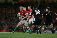 Alun-Wyn Jones of Wales looks to go past Piri Weepu (20). Invesco Perpetual series 2008 autumn international match, Wales v New Zealand at the Millennium Stadium on Sat 22nd Nov 2008. pic by Andrew Orchard, Andrew Orchard sports photography,