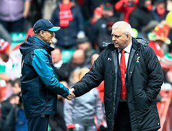 Head Coach Warren Gatland of Wales with Head Coach Joe Schmidt of Ireland during the pre match warm up<br /> <br /> Photographer Simon King/Replay Images<br /> <br /> Six Nations Round 5 - Wales v Ireland - Saturday 16th March 2019 - Principality Stadium - Cardiff<br /> <br /> World Copyright © Replay Images . All rights reserved. info@replayimages.co.uk - http://replayimages.co.uk