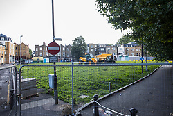 London, UK. 14th August, 2021. Fencing has been installed around Peckham Green by Southwark Council, which plans to develop it as public housing. Peckham Green is a 1.4-acre public park off Peckham High Street, one of the most polluted roads in London, in a borough which is ranked fifth-worst in London and eighth-worst in the UK for easy access to green space, and local residents and campaigners have been protesting against a lack of consultation by Southwark Council in relation to its plans.