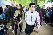 A woman carrying her dog at Vietnam Open Festival 2013 (VOF 2013) is a Vietnamese cultural festival celebrating the very best of Vietnam in London. Held on the Southbank Riverside, the local diaspora mix with multi cultural Londoners.
