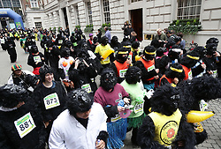 Participants in fancy dress start the Great Gorilla Run race at Minster Court, London.