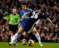 Photo: Ed Godden/Sportsbeat Images.<br />Chelsea v Wigan Athletic. The Barclays Premiership. 13/01/2007. Chelsea's Michael Ballack (L), attempts to stop the advancing Leighton Baines.