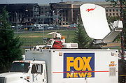 Days after the 9-11 terrorist attacks, a Fox News satellite truck is positioned opposite the Pentagon which was badly damaged by the crashed Americans Airline flight 77, on 18th September 2001, Washington DC, USA.