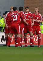 Photo: Paul Greenwood.<br />Wigan Athletic v Liverpool. The Barclays Premiership. 02/12/2006. Liverpool players mob goalscorer Craig Bellamy. (unseen)