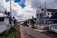 Indonesia, Sulawesi, Rurukan. Church in Rurukan village. School children lining up outside the school.