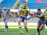 Warrington Wolves' Ben Currie tries to gather under pressure from Catalans Dragons' Dean Whare<br /> <br /> Photographer Alex Dodd/CameraSport<br /> <br /> Rugby League - Betfred Challenge Cup Quarter Finals - Catalans Dragons v Warrington Wolves - Friday 7th May 2021 - Emerald Headingley Stadium - Leeds<br /> <br /> World Copyright © 2021 CameraSport. All rights reserved. 43 Linden Ave. Countesthorpe. Leicester. England. LE8 5PG - Tel: +44 (0 116 277 4147 - admin@camerasport.com - www.camerasport.com