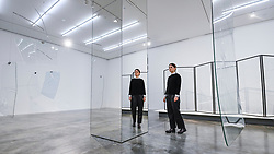 """© Licensed to London News Pictures. 06/02/2020. LONDON, UK. A staff member next to a series of screens called """"phase shifts (after David Tudor)"""", 2020, by Cerith Wyn Evans. Preview of """"No realm of thought... No field of vision"""" by Cerith Wyn Evans at the White Cube gallery in Bermondsey.  The exhibition runs 7 February to 19 April 2020.  The show comprises installations, sculpture and painting.  Photo credit: Stephen Chung/LNP"""