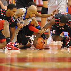 Rutgers Scarlet Knights guard/forward Mike Poole (10), guard Myles Mack (4), guard Eli Carter (5) and Seton Hall Pirates guard Jordan Theodore (1) dive for a loose ball during second half Big East NCAA Basketball between the Rutgers Scarlet Knights and Seton Hall Pirates at the Louis Brown Athletic Center. Seton Hall defeated Rutgers 59-55.