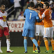 Houston players Tally Hall, Eric Brunner and Bobby Boswell celebrate their sides victory at the final whistle watch by Thierry Henry, New York Red Bulls, during the New York Red Bulls V Houston Dynamo, Major League Soccer second leg of the Eastern Conference Semifinals match at Red Bull Arena, Harrison, New Jersey. USA. 6th November 2013. Photo Tim Clayton