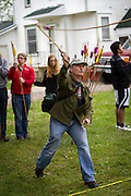Professor of Anthropology Eric Whitaker lets an atlatl dart fly with textbook form during the Raging Cow atlatl tournament at Grinnell College. BEN BREWER/Grinnell College