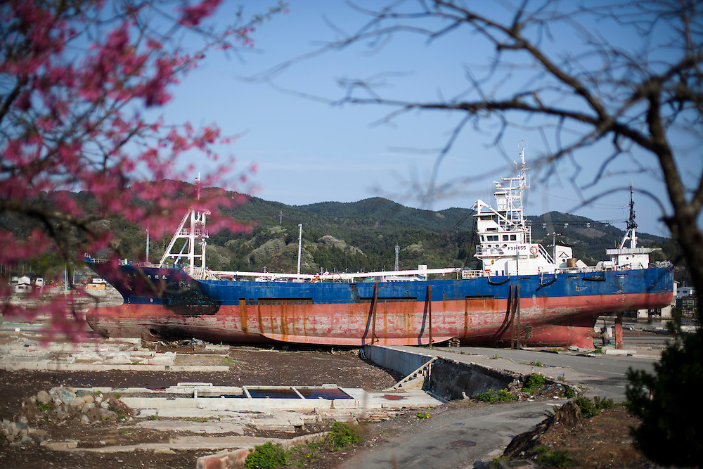 A big fishing boat was swept and lies on the ground.