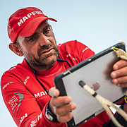 Leg 4, Melbourne to Hong Kong, day 10 on board MAPFRE, Xabi Fernandez with the ipad comenting the last sched with the crew on deck. Photo by Ugo Fonolla/Volvo Ocean Race. 11 January, 2018.