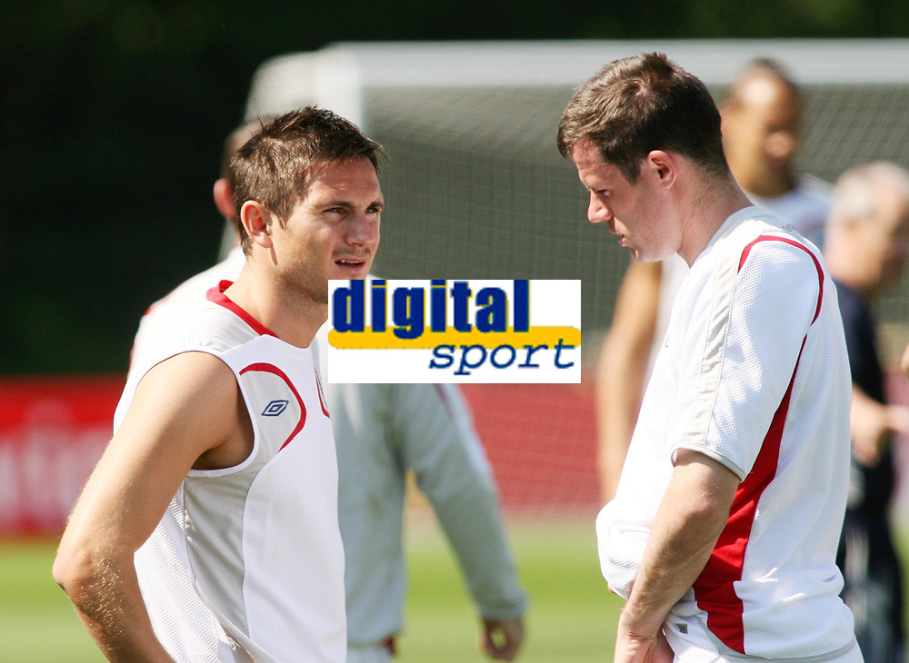 Photo: Chris Ratcliffe.<br />England Training Session. FIFA World Cup 2006. 13/06/2006.<br />Frank Lampard chats with Jamie Carragher during training.