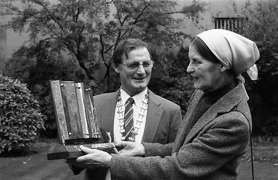 Joan Denise Moriarty..1983.09.11.1983.11.09.1983.9th November 1983..At the Mansion House,Dublin,a V.A.T.S award (Variety ArtistesTrust Society) was made to Joan Denise Moriarty.It was in recognition of her work in Irish Theatre. Ms Moriarty was a noted ballet dancer, choreographer and teacher of ballet.. She was also noted as a traditional Irish dancer and musician.A formal presentation of the award will be made at the forthcoming concert in The Opera House,Cork,on November 20th..Pictured with Ms Moriarty as she admires the award is, Mr Jimmy Ryan, Chairman of V.A.T.S...Addendum: Ms Moriarty Passed away in January 1992..