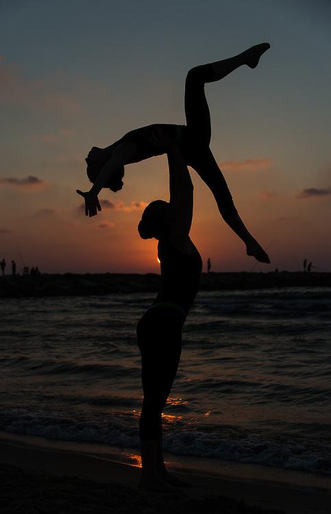 Members of the Ganei Tikva Maccabi Leader  acrobatics team on the beach in Tel Aviv