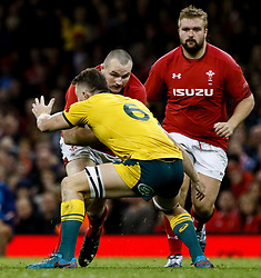 Ken Owens of Wales under pressure from Jack Dempsey of Australia<br /> <br /> Photographer Simon King/Replay Images<br /> <br /> Under Armour Series - Wales v Australia - Saturday 10th November 2018 - Principality Stadium - Cardiff<br /> <br /> World Copyright © Replay Images . All rights reserved. info@replayimages.co.uk - http://replayimages.co.uk