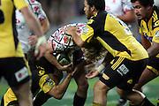 Lachie Turner runs at Piri Weepu. NSW Waratahs v Hurricanes. 2010 Super 14 Rugby Union round 14 match played at the Sydney Football Stadium, Moore Park Australia. Friday 14 May 2010. Photo: Clay Cross/PHOTOSPORT
