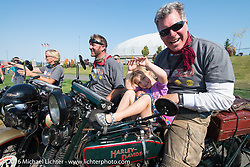 Team Vino's Dean Bordigioni celebrate with his daughter after crossing the finish line at the end of Stage 16 (142 miles) of the Motorcycle Cannonball Cross-Country Endurance Run, which on this day ran from Yakima to Tacoma, WA, USA. Sunday, September 21, 2014.  Photography ©2014 Michael Lichter.