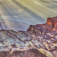 A memory of nature's unique beauty. Sun rays shining over the landscape at Zabriskie Point