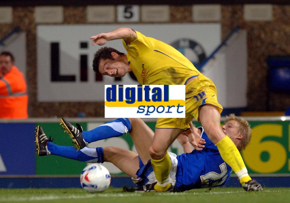 Photo: Ashley Pickering.<br />Ipswich Town v Preston North End. Coca Cola Championship. 17/10/2006.<br />Ipswich's Dan Harding tangles with Preston's David Nugent