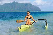 Polynesian woman on outrigger canoe, Kaneohe Bay, Oahu, Hawaii