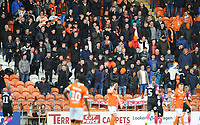 Blackpool fans, some in balaclavas, watch their team in action<br /> <br /> Photographer Kevin Barnes/CameraSport<br /> <br /> The EFL Sky Bet Championship - Blackpool v Peterborough United - Saturday 2nd November 2019 - Bloomfield Road - Blackpool<br /> <br /> World Copyright © 2019 CameraSport. All rights reserved. 43 Linden Ave. Countesthorpe. Leicester. England. LE8 5PG - Tel: +44 (0) 116 277 4147 - admin@camerasport.com - www.camerasport.com