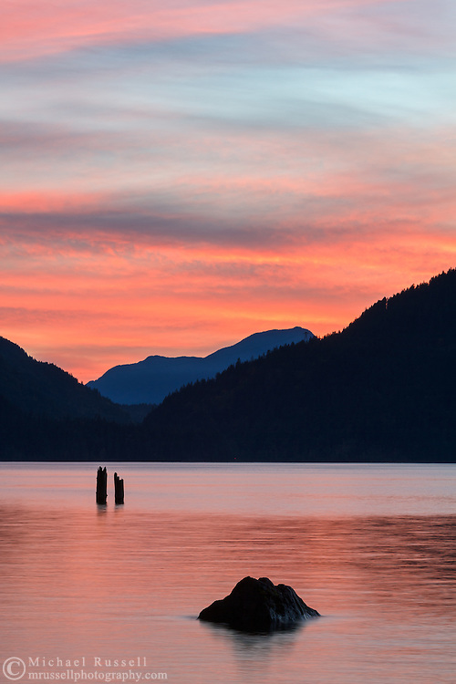 A vivid sunset at Harrison Lake near Harrison Hot Springs, British Columbia, Canada. The distant mountain peak to the west is Sasin Peak.