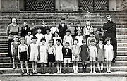 class school group portrait with teacher and priest 1950s France