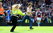 an Aston Villa fan invades the pitch after Gabriel Agbonlahor scores a goal and makes it 1-0.  EFL Skybet championship match, Aston Villa v Birmingham city at Villa Park in Birmingham, The Midlands on Sunday 23rd April 2017.<br /> pic by Bradley Collyer, Andrew Orchard sports photography.