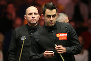 Joe Perry (Eng) on the left looks on as Ronnie O'Sullivan prepares to take a shot. , Ronnie O'Sullivan (Eng) v Joe Perry (Eng), the Masters Final at the Dafabet Masters Snooker 2017, at Alexandra Palace in London on Sunday 22nd January 2017.<br /> pic by John Patrick Fletcher, Andrew Orchard sports photography.