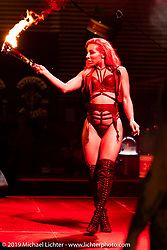 A British dance group named the Valkyries performed their version of fire show and burlesque at the Swiss-Moto Customizing and Tuning Show. Zurich, Switzerland. Friday, February 22, 2019. Photography ©2019 Michael Lichter.