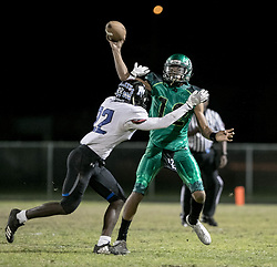 November 17, 2017 - Delray Beach, Florida, U.S. - Atlantic Eagles quarterback Antoine Williams II (12) throws a pass as he is pressured by Park Vista Cobras Ivan Johnson (22) in Delray Beach, Florida on November 17, 2017. (Credit Image: © Allen Eyestone/The Palm Beach Post via ZUMA Wire)