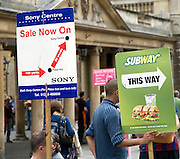 Street advertising signs held by men, Bath