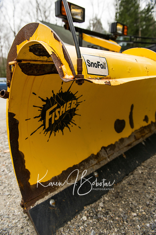 """Sums is up """"snow foiled"""" with this snow plow not seeing much use through the """"winter that wasn't"""".   (Karen Bobotas/for the Laconia Daily Sun)"""