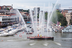 © Licensed to London News Pictures.  21/07/2018; Bristol, UK. Bristol Harbour Festival. The Pyronaut fire boat gives a display. People enjoy the good weather during the Bristol Harbour Festival in the city centre of Bristol. Bristol Harbour Festival is a 3 day extravaganza of dance, music, theatre, circus, ships and boats, arts and delicious food. The festival is free for all and brings over 250,000 people together each summer to celebrate Bristol's rich maritime history and enjoy some of the city's best music and entertainment. The festival takes place on the  20 - 22 July 2018. Photo credit: Simon Chapman/LNP