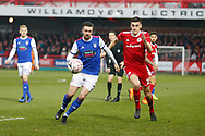 Ipswich Town midfielder Gwion Edwards (7) and Accrington Stanley defender Ross Sykes (15) contest a loose ball  during the The FA Cup 3rd round match between Accrington Stanley and Ipswich Town at the Fraser Eagle Stadium, Accrington, England on 5 January 2019.