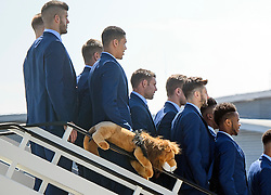 © Licensed to London News Pictures. 06/06/2016. Luton, UK. Members of England national football squad pose for a photograph with a stuffed lion toy as they board a plane at Luton airport in Bedfordshire, England, to head for their training camp in France, ahead of the start of the UEFA Euro 2016 championships.  Photo credit: Ben Cawthra/LNP