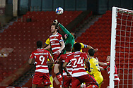 Doncaster goalkeeper Ellery Balcombe punches clear during the EFL Sky Bet League 1 match between Doncaster Rovers and AFC Wimbledon at the Keepmoat Stadium, Doncaster, England on 26 January 2021.