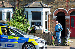 © Licensed to London News Pictures. 25/04/2020. London, UK. A forensic investigator at the scene of a fatal house fire. A man has died in a house fire in Earlsfield, Wandsworth. Firefighters found the man in a ground floor bedroom. He was brought out of the property by fire crews but he died at the scene. London Fire Brigade was called at 07:36 BST and the fire was under control by 08:33 BST. Photo credit: Peter Manning/LNP