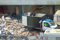 © Licensed to London News Pictures. 15/02/2020. London, UK.  A group of travellers have occupied vacant land in Alperton, North West London since the beginning of February. Men have ben using trucks to collect rubbish and have been illegally fly-tipping on the land. It is reported the land owners have applied to the court for the evection of the travellers. Photo credit: London News Pictures