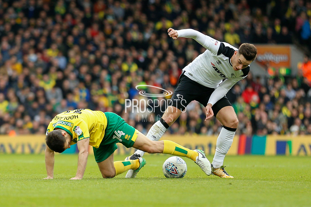 Norwich City midfielder Wesley Hoolahan (14) & Derby County forward Tom Lawrence battles for possession during the EFL Sky Bet Championship match between Norwich City and Derby County at Carrow Road, Norwich, England on 28 October 2017. Photo by Phil Chaplin.