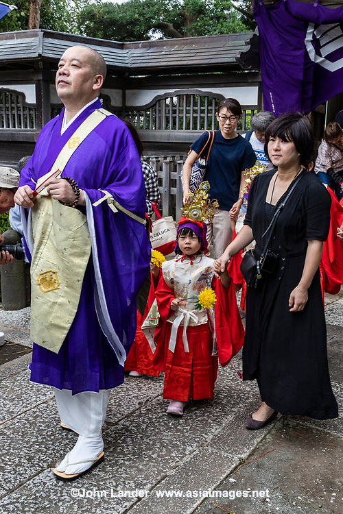 Chigo Gyoretsu is a colourful children's procession that promotes wishes for kids' happiness and health.  In Japanese, chigo means small child'and gyoretsu means procession - And so chigo-gyoretsu means exactly that – a procession of small children. At this festival, kids aged three to five dress up in orange and purple to wish for growth and health. Wearing matching costumes, the boys wear a stiff hat of lacquered gauze called an eboshi, while the girls wear a crown with a phoenix bird and bright metal pendants called a tenkan.  Although this ceremony is typically performed at shinto shrines, it is increasing praticied at Buddhist temples in Japan.  It is similar to 7-5-3 or Shichi Go San where kids of those ages are trotted out in their finest at the local shinto shrine on November 16.  Since Chigo Gyorentsu usually is performed in September or October, it would be repetitative to perform  similar rites at a shrine, which is probably why it is being celebrated at Buddhist temples.